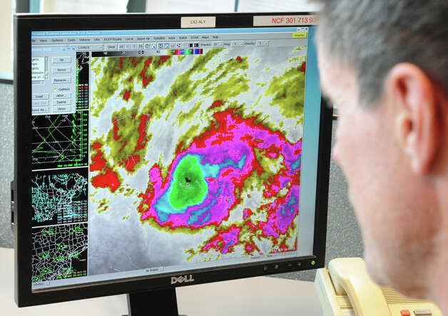 Meteorologist Hugh Johnson works on tracking Hurricane Sandy at the National Weather Service on Fuller Rd. on Thursday, Oct. 25, 2012 in Albany, N.Y.  (Lori Van Buren / Times Union) Photo: Lori Van Buren