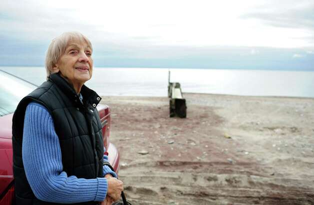 Albina Cappiello, 86, looks at her home on Shoreline Drive in Stratford, where she has lived for over 40 years, as she talks about the toll from Hurricane Irene Thursday, Oct. 25, 2012. Photo: Autumn Driscoll
