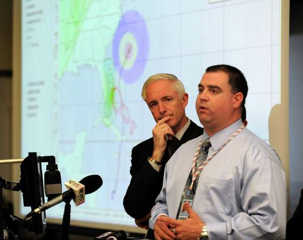 Mayor Bill Finch listens as Scott Appleby, director Office of Emergency Management and Homeland Security, addresses the media at a informational session on storm preparedness for hurricane Sandy. The meeting with City public safety officials was held at the Emergency Operations Center, 581 North Washington Ave., in Bridgeport, Conn. on Thursday, Oct. 25, 2012. Photo: Cathy Zuraw