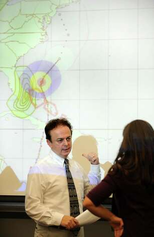 Bill Jacquemin, Meteorologist Connecticut Weather Center, discusses storm preparedness for hurricane Sandy in a meeting at the Emergency Operations Center, 581 North Washington Ave., in Bridgeport, Conn. on Thursday, Oct. 25, 2012. Photo: Cathy Zuraw