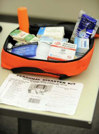 An example of a personal disaster kit was on display at the storm preparedness for hurricane Sandy meeting at the Emergency Operations Center, 581 North Washington Ave., in Bridgeport, Conn. on Thursday, Oct. 25, 2012. Mayor Bill Finch and City public safety officials addressed the media on safety steps that should be taken and where to tune in for updated information as the storm approaches. Photo: Cathy Zuraw