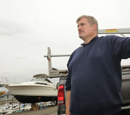 Anthony Rizzi at the Cos Cob docks, Thursday afternoon, Oct. 25, 2012.  Rizzi who runs a marine service business says he has been busy taking his  client's boats out of the water before Hurricane Sandy hits the area on Monday or Tuesday. Photo: Bob Luckey / Greenwich Time