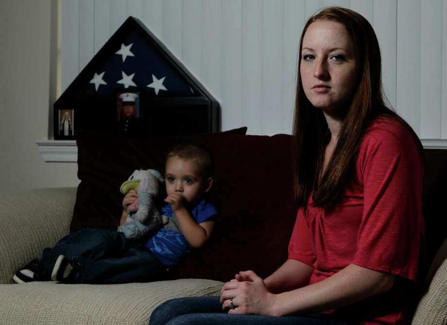 Kristin Segura, widow of Iraq war veteran Alex Segura, shares an apartment with their 2-year-old son, Xavier, near her parents in Conroe.  Photo: Melissa Phillip, Staff / Houston Chronicle