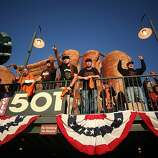Friends from Sacramento, (L-R) Adam Della Monica, Jake Luke and Kevin Mock celebrate in the outfield during game 2 of the World Series between the Detroit Tigers and the San Francisco Giants at AT&T Park Thursday, October 25, 2012 in San Francisco, Calif.
