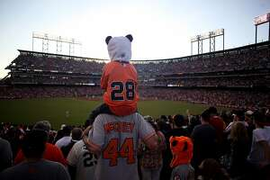 Zach Elizalde, 6, wears a Panda hat and sits on his dads, Eric Elizalde, shoulders during game 2 of the World Series between the Detroit Tigers and the San Francisco Giants at AT&T Park Thursday, October 25, 2012 in San Francisco, Calif.