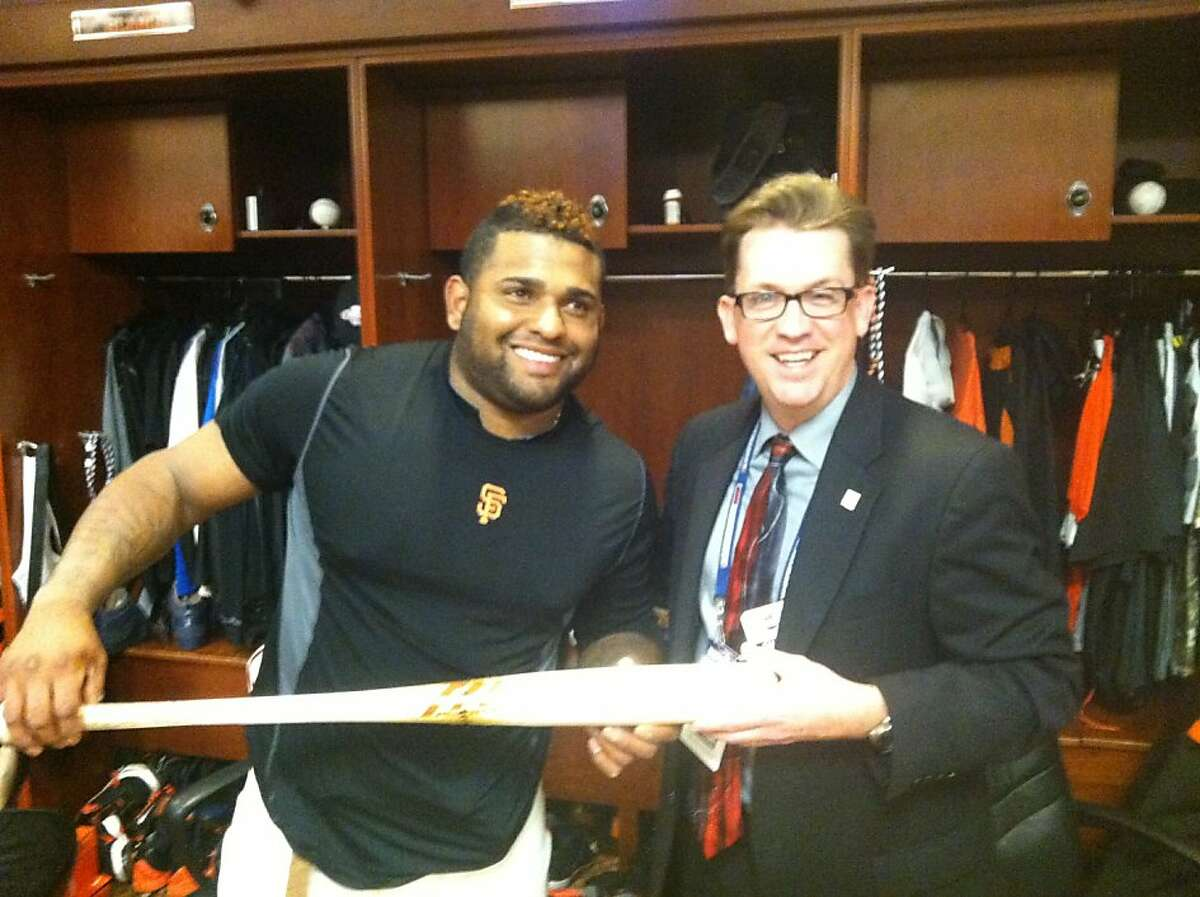 Pablo Sandoval giving bat he used to hit two home runs off the Tigers' Justin Verlander, to Hall of Fame representative Brad Horn after Game 1 of the World Series.