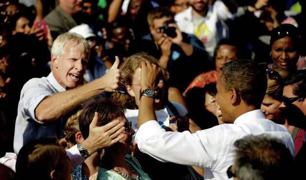 An unidentified supporter gives President Barack Obama a 'thumbs-up' at a campaign event at the Carillon at Byrd Park, Thursday, Oct. 25, 2012, in Richmond Va. The president is on the second day of his 48 hour, 8 State campaign blitz. (AP Photo/Pablo Martinez Monsivais) Photo: Pablo Martinez Monsivais