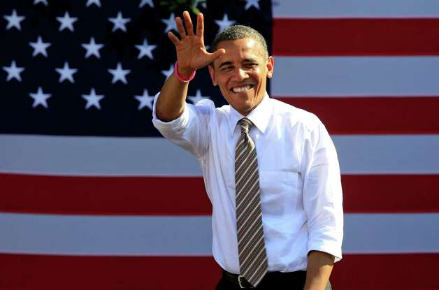 President Barack Obama waves to supporters during a campaign rally in Byrd Park in Richmond, Va., Thursday, Oct. 25, 2012. The president is on the second day of his 48 hour, 8 State campaign blitz.  (AP Photo/Steve Helber) Photo: Steve Helber