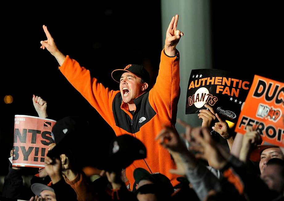 There was plenty of black and orange on display outside AT&T Park as fans celebrated after Wednesday's victory. Photo: Noah Berger, Special To The Chronicle