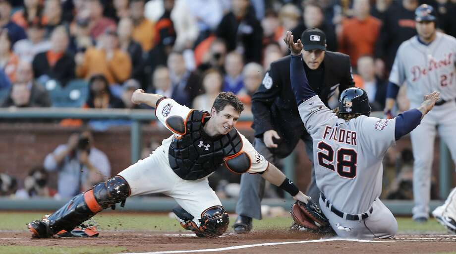Giants' catcher Buster Posey makes the play at home against Tigers' first baseman Prince Fielder  in the 2nd inning during game 2 of the World Series at AT&T Park on Thursday, Oct. 25, 2012 in San Francisco, Calif. Photo: Michael Macor, The Chronicle