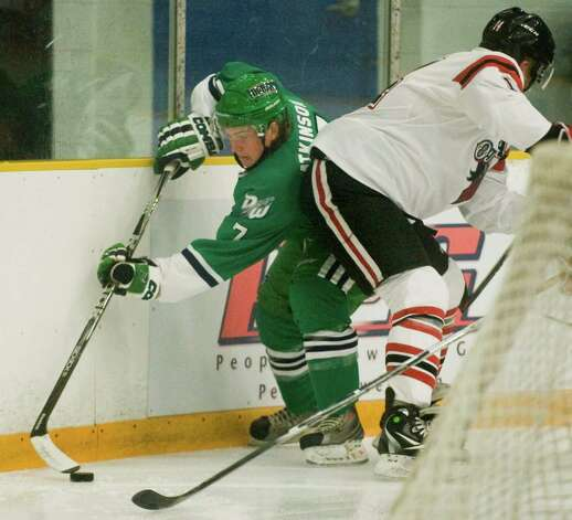 Danbury Whalers Mike Atkinson tries to work the puck while pinned along the boards during a game against the Williamsport Outlaws played at the Danbury Arena. Thursday, Oct. 25, 2012 Photo: Scott Mullin