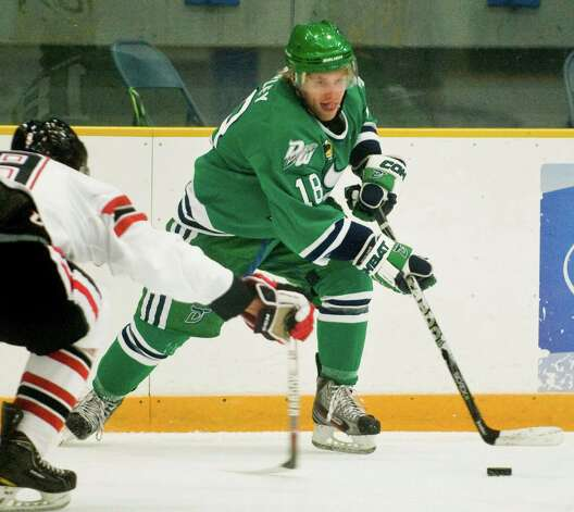 Danbury Whalers Max Mobley tries to control the puck during a game against the Williamsport Outlaws, played at the Danbury Arena. Thursday, oct. 25, 2012 Photo: Scott Mullin