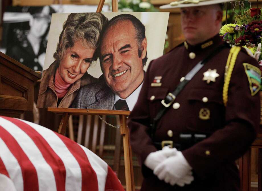 A photograph of former Democratic U.S. senator and three-time presidential candidate George McGovern and his late wife Eleanor, sits next to Sen. McGovern's casket during a public viewing at the First United Methodist Church in Sioux Falls, S.D., Thursday. Photo: M. Spencer Green, Associated Press / AP POOL