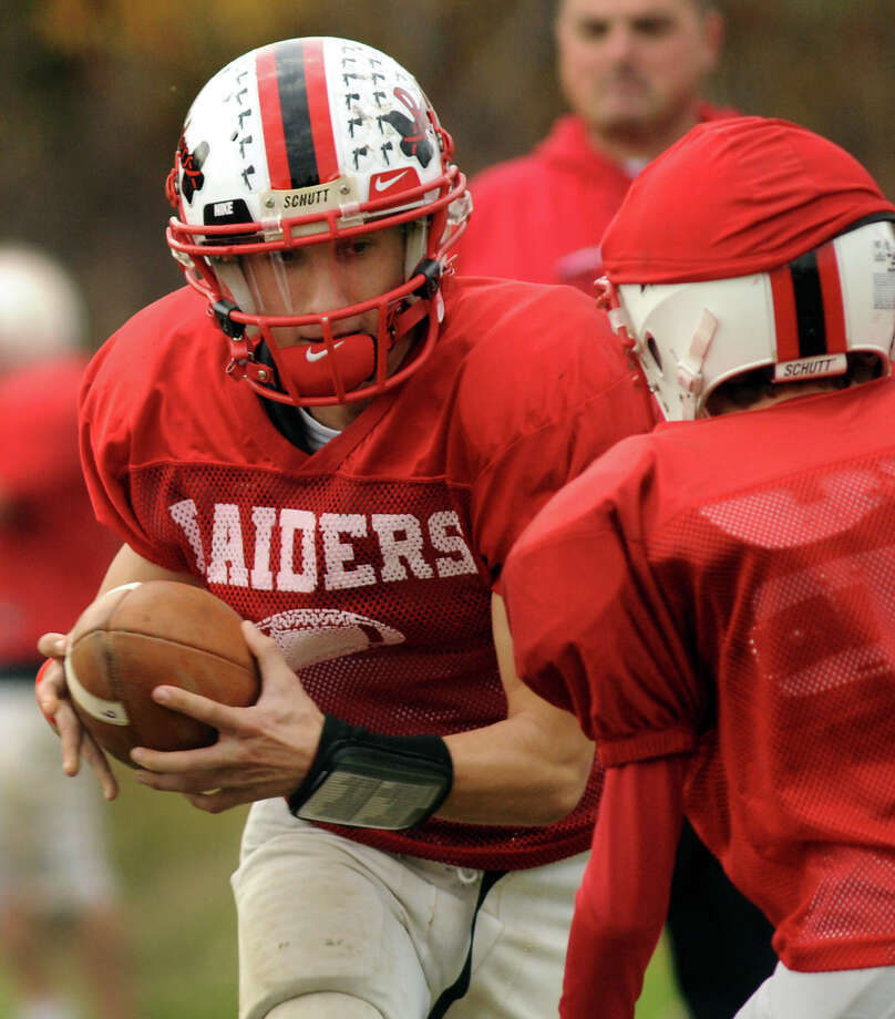 Quarterback Sal Cimino fakes a handoff and gets ready to pass during practice on Thursday, Oct. 25, 2012, at Mechanicville High in Mechanicville, N.Y. (Cindy Schultz / Times Union) Photo: Cindy Schultz / 00019835A
