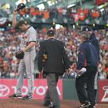 Tigers' pitcher Doug Fister wipes away sweat in the 2nd inning after getting hit by a ball during game 2 of the World Series at AT&T Park on Thursday, Oct. 25, 2012 in San Francisco, Calif.