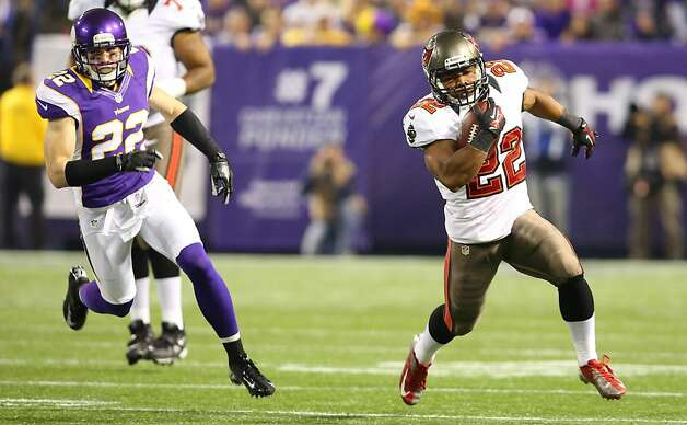 Bucs running back Doug Martin runs for some of his 214 yards from scrimmage. Photo: Adam Bettcher, Getty Images