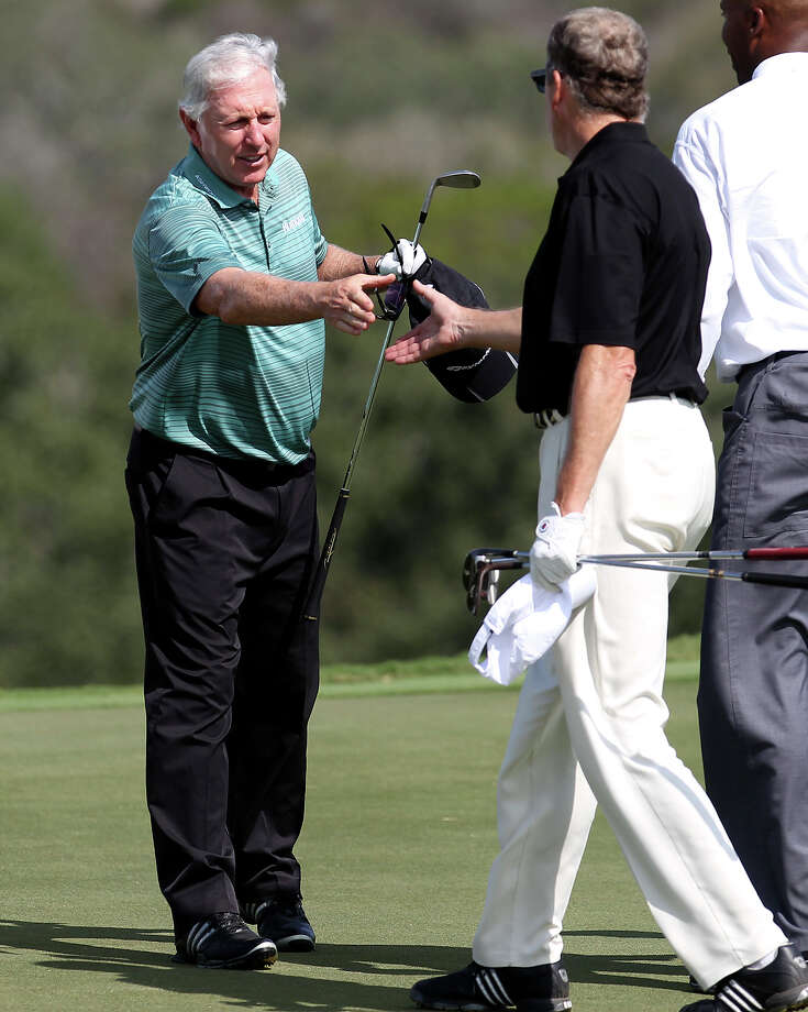 Pro golfer Hale Irwin shakes hands with golfers on No. 18 on the last day of the AT&T Champion pro-am rounds at the TPC San Antonio, Canyons Course on Thursday, Oct. 25, 2012. Photo: Kin Man Hui, Express-News / © 2012 San Antonio Express-News
