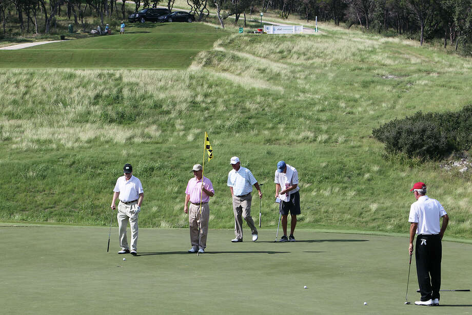 Golfers study their putts on No. 16 on the last day of the AT&T Champion pro-am rounds at the TPC San Antonio, Canyons Course on Thursday, Oct. 25, 2012. The par three, No. 16 is expected to be a tough hole for the players this weekend. Photo: Kin Man Hui, Express-News / © 2012 San Antonio Express-News
