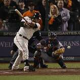 Giants' shortstop Brandon Crawford grounds into a double play scoring Hunter Pence in the 7th inning during the World Series game 2 at AT&T Park in San Francisco, Calif., on Thursday, Oct. 25, 2012.t