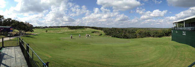A panoramic shot of golfers putting on the No. 16 green on the last day of the AT&T Champion pro-am rounds at the TPC San Antonio, Canyons Course on Thursday, Oct. 25, 2012. No. 16 is expected to be a tough hole for the players this weekend. Photo: Kin Man Hui, Express-News / © 2012 San Antonio Express-News