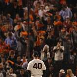Fans cheer as Giants' pitcher Madison Bumgarner gets ready to pitch in the 7th inning during the World Series game 2 at AT&T Park in San Francisco, Calif., on Thursday, Oct. 25, 2012.