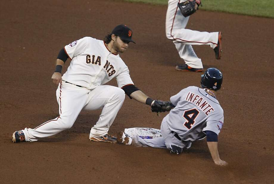 Giants shortstop Brandon Crawford tags out the Tigers' Omar Infante, who was trying to steal second in Game 2. Crawford has thrived with experience. Photo: Brant Ward, The Chronicle