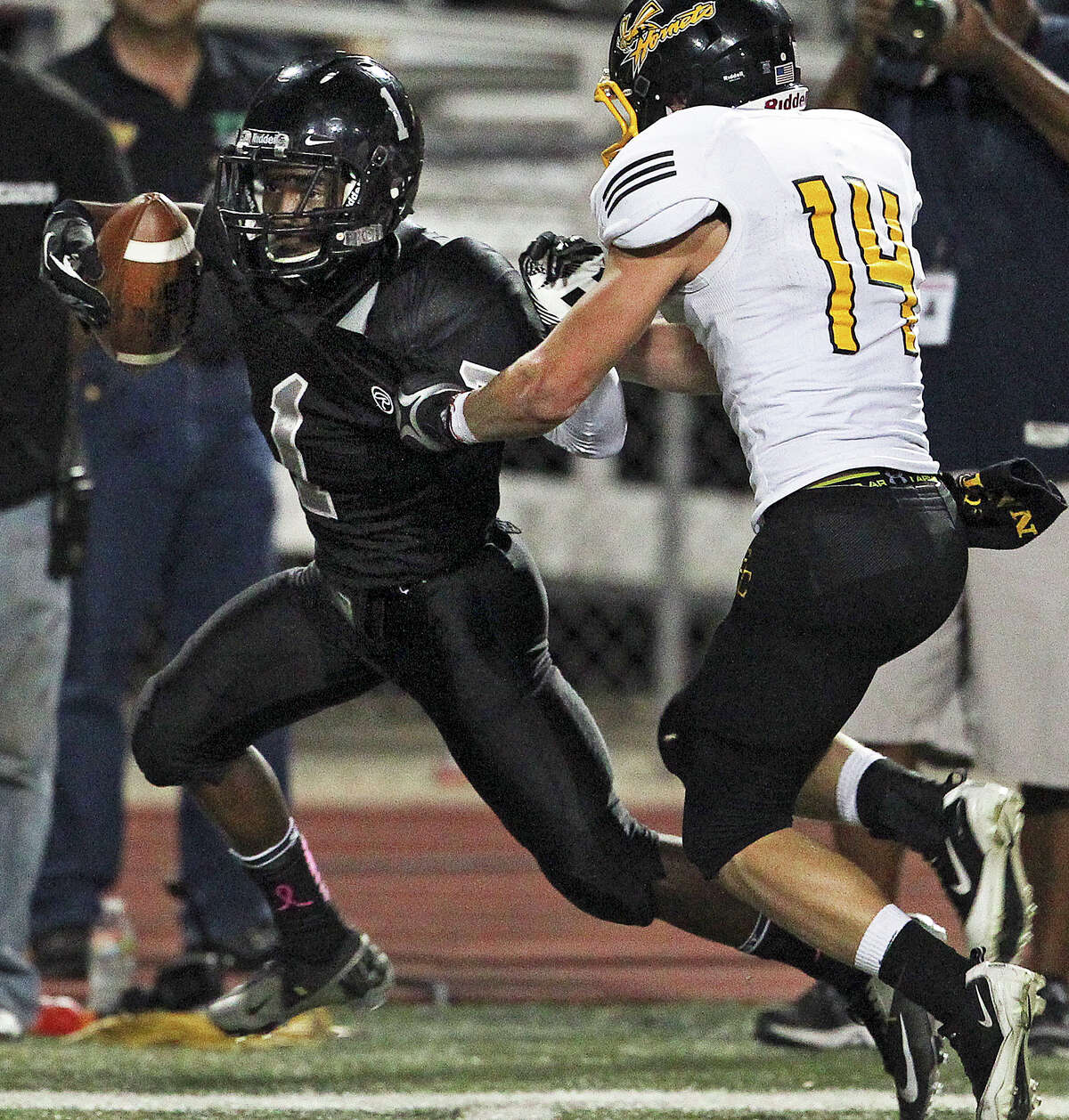 Knight running back Jaylen Harris nearly breaks loose on a long catch against Russell Brown as Steele hosts East Central at Lehnhoff Stadium on October 25, 2012.