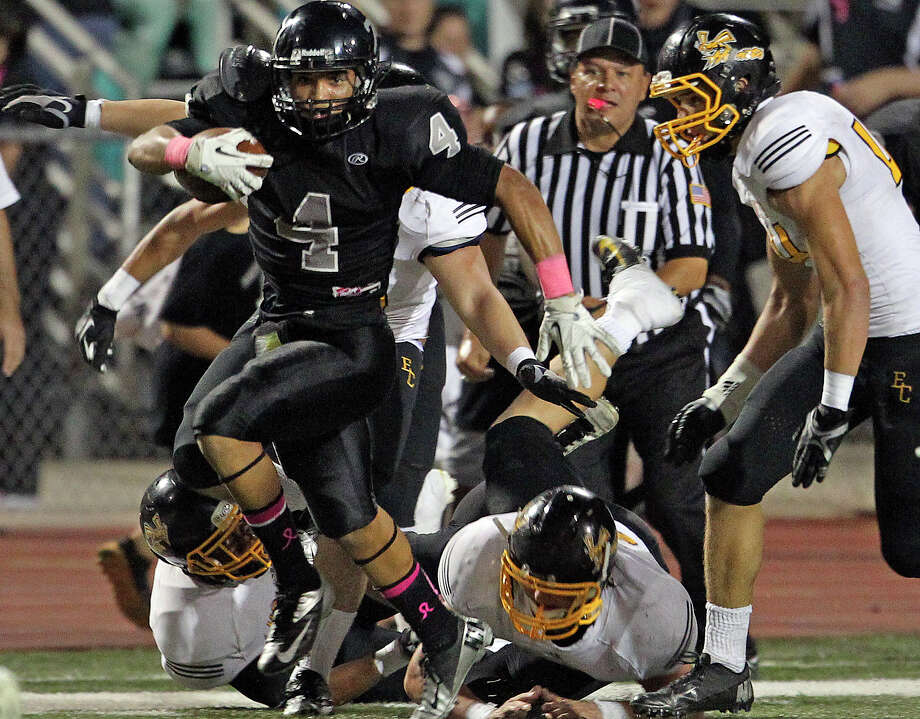 Justin Stockton scatters defenders along the sideline as he breaks loose in the second half for the Knights as Steele hosts East Central at Lehnhoff Stadium on October 25, 2012. Photo: Tom Reel, Express-News / ©2012 San Antono Express-News