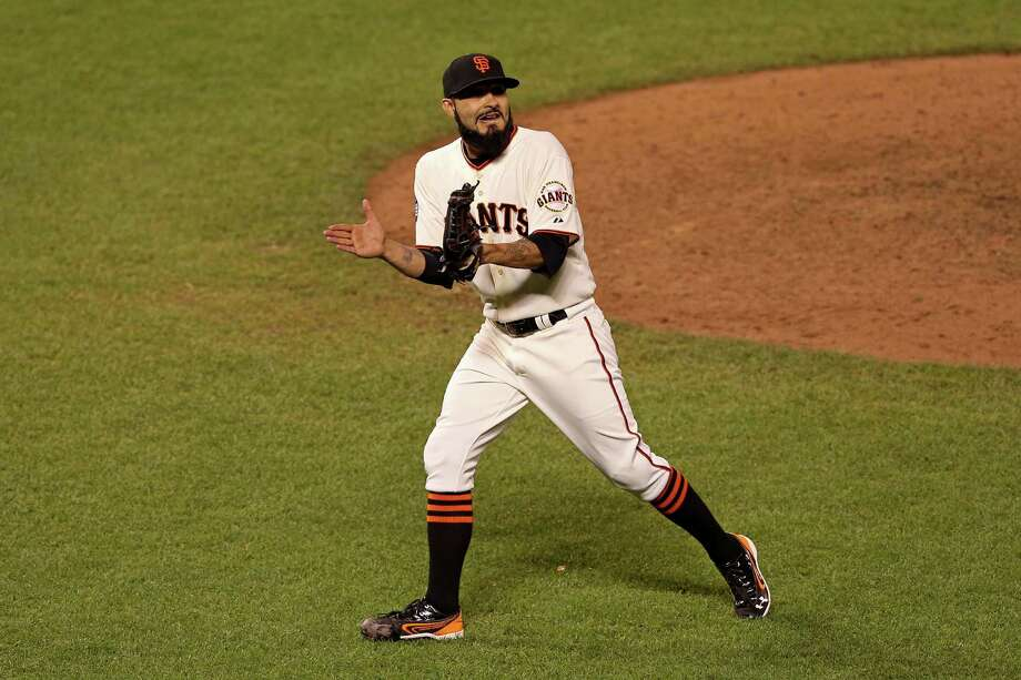 SAN FRANCISCO, CA - OCTOBER 25:  Sergio Romo #54 of the San Francisco Giants reacts after Omar Infante #4 of the Detroit Tigers fouled out for the final out of the game in the ninth inning during Game Two of the Major League Baseball World Series at AT&T Park on October 25, 2012 in San Francisco, California. The Giants won 2-0. Photo: Ezra Shaw, Getty Images / Getty Images North America