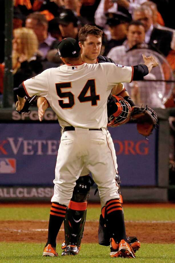 SAN FRANCISCO, CA - OCTOBER 25:  Sergio Romo #54 and Buster Posey #28 of the San Francisco Giants celebrate after they won 2-0 against the Detroit Tigers during Game Two of the Major League Baseball World Series at AT&T Park on October 25, 2012 in San Francisco, California. Photo: Jason O. Watson, Getty Images / Getty Images North America