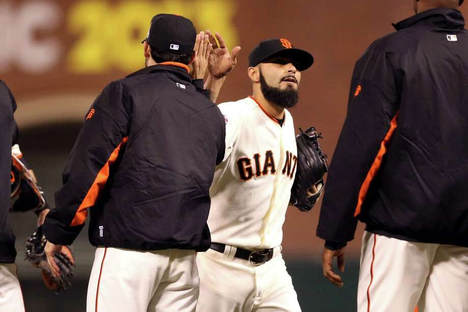 SAN FRANCISCO, CA - OCTOBER 25:  Sergio Romo #54 of the San Francisco Giants celebrates after the Giants won 2-0 against the Detroit Tigers during Game Two of the Major League Baseball World Series at AT&T Park on October 25, 2012 in San Francisco, California. Photo: Christian Petersen, Getty Images / Getty Images North America