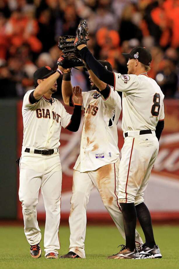 SAN FRANCISCO, CA - OCTOBER 25:  (L-R) Gregor Blanco #7, Angel Pagan #16 and Hunter Pence #8 of the San Francisco Giants celebrate after they won 2-0 against the Detroit Tigers during Game Two of the Major League Baseball World Series at AT&T Park on October 25, 2012 in San Francisco, California. Photo: Doug Pensinger, Getty Images / Getty Images North America