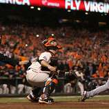 San Francisco Giants catcher Buster Posey and umpire Dan Iassogna watch  Detroit Tigers Omar Infante fly ball get catched for the final out of game two of the World Series Thursday, October 25, 2012 in San Francisco, California. Giants won 2-0