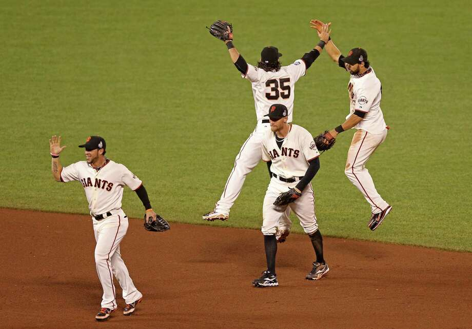 SAN FRANCISCO, CA - OCTOBER 25:  (L-R) Gregor Blanco #7, Brandon Crawford #35, Hunter Pence #8 and Angel Pagan #16 of the San Francisco Giants celebrate after they won 2-0 against the Detroit Tigers during Game Two of the Major League Baseball World Series at AT&T Park on October 25, 2012 in San Francisco, California. Photo: Ezra Shaw, Getty Images / Getty Images North America