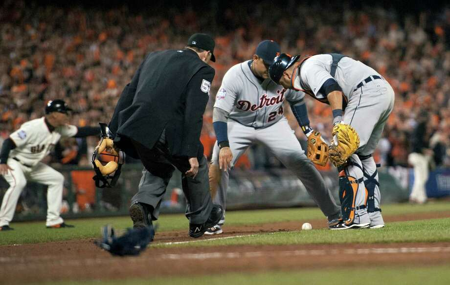 Detroit Tigers third baseman Miguel Cabrera (24) and catcher Gerald Laird, right, watch the San Francisco Giants' Gregor Blanco's bunt in the seventh inning in Game 2 of the 2012 World Series at AT&T Park on Thursday, October 25, 2012, in San Francisco, California. The Giants won, 2-0, to take a 2-0 series lead. (Paul Kitagaki Jr./Sacramento Bee/MCT) Photo: Paul Kitagaki Jr., McClatchy-Tribune News Service / ARCHIVE