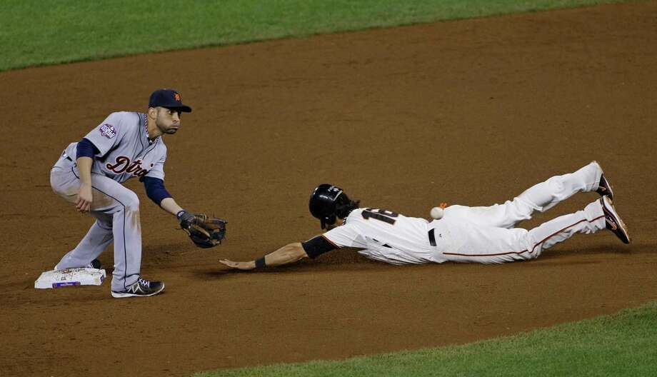 San Francisco Giants' Angel Pagan steals second with Detroit Tigers' Omar Infante covering during the eighth inning of Game 2 of baseball's World Series Thursday, Oct. 25, 2012, in San Francisco. The Giants won 2-0 to take a 2-0 lead in the series.  (AP Photo/Jeff Chiu) Photo: Jeff Chiu, Associated Press / AP