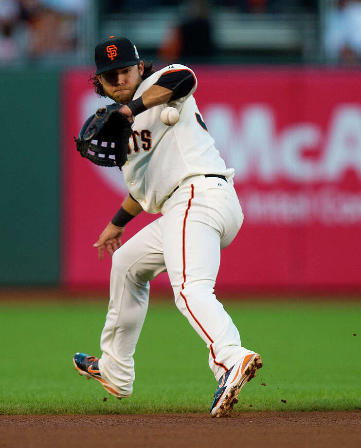 San Francisco Giants shortstop Brandon Crawford bobbles a single by Detroit Tigers' Omar Infante during the fourth inning in Game 2 of baseball's World Series, Thursday, Oct. 25, 2012, in San Francisco. (AP Photo/The Sacramento Bee, Jose Louis Villegas) MAGS OUT; TV OUT (KCRA3, KXTV10, KOVR13, KUVS19, KMAZ31, KTXL40) MANDATORY CREDIT Photo: Jose Luis Villegas, Associated Press / The Sacramento Bee