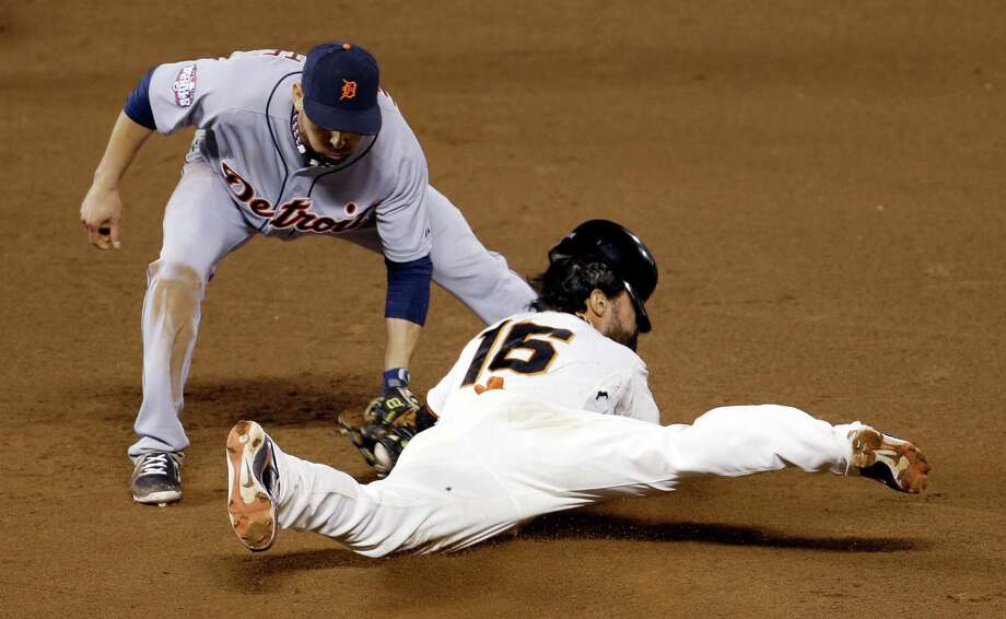 San Francisco Giants' Angel Pagan steals second with Detroit Tigers' Omar Infante covering during the eighth inning of Game 2 of baseball's World Series Thursday, Oct. 25, 2012, in San Francisco. The Giants won 2-0 to take a 2-0 lead in the series. (AP Photo/Eric Risberg) Photo: Eric Risberg, Associated Press / AP