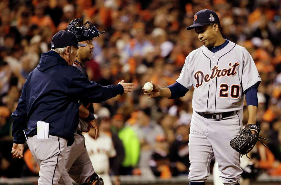 Detroit Tigers relief pitcher Octavio Dotel (20) hands the ball to manager Jim Leyland as he is taken out of the game during the eighth inning of Game 2 of baseball's World Series against the San Francisco Giants Thursday, Oct. 25, 2012, in San Francisco. (AP Photo/David J. Phillip) Photo: David J. Phillip, Associated Press / AP