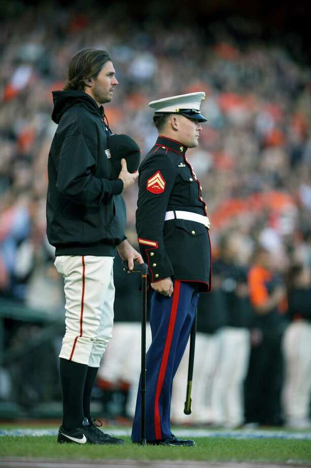 San Francisco Giants pitcher Barry Zito stands with Corporal Nicholas Kimmel, a triple amputee and veteran of Afghanistan, during pre-game ceremonies ahead of Game 2 of the 2012 World Series at AT&T Park on Thursday, October 25, 2012, in San Francisco, California. (Paul Kitagaki Jr./Sacramento Bee/MCT) Photo: Paul Kitagaki Jr., McClatchy-Tribune News Service / ARCHIVE