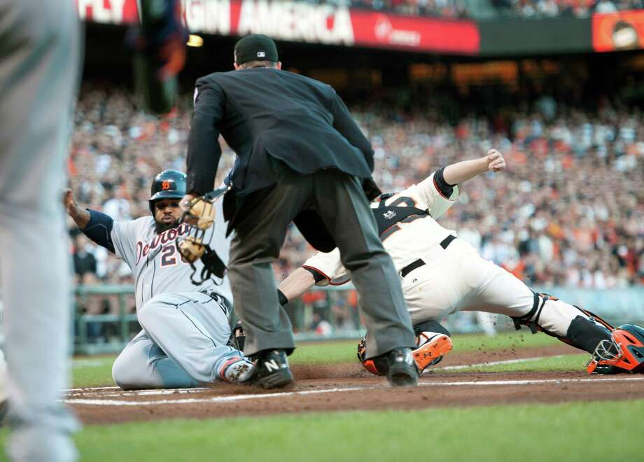The Detroit Tigers' Prince Fielder is tagged out by San Francisco Giants catcher Buster Posey, right, in the second inning in Game 2 of the 2012 World Series at AT&T Park on Thursday, October 25, 2012, in San Francisco, California. (Paul Kitagaki Jr./Sacramento Bee/MCT) Photo: Paul Kitagaki Jr., McClatchy-Tribune News Service / ARCHIVE