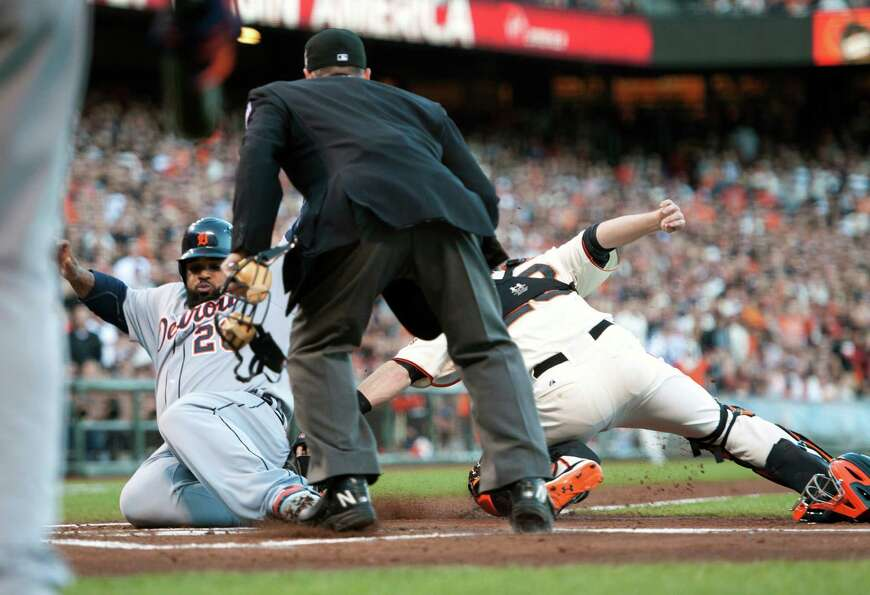 Detroit Tigers' Prince Fielder (28) is tagged out by San Francisco Giants catcher Buster Posey durin