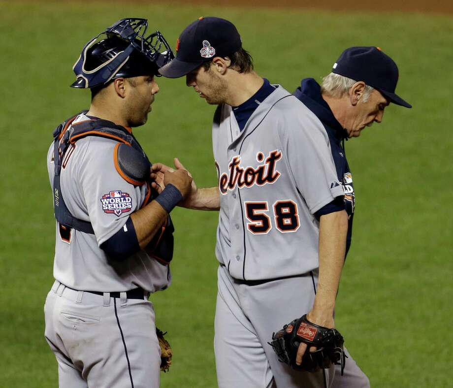 Detroit Tigers starting pitcher Doug Fister is congratulated by catcher Gerald Laird after being replaced during the seventh inning of Game 2 of baseball's World Series against the San Francisco Giants Thursday, Oct. 25, 2012, in San Francisco. (AP Photo/Eric Risberg) Photo: Eric Risberg, Associated Press / AP