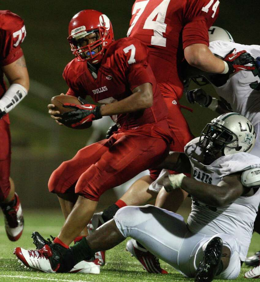Dulles quarterback Robert Harris (7) is sacked by Hightower defensive lineman Derrick Smith during the second half of a high school football game, Thursday, October 25, 2012 at Mercer Stadium in Sugar Land, TX. Photo: Eric Christian Smith, For The Chronicle