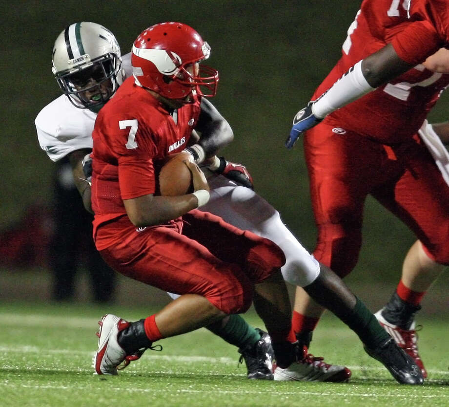 Dulles quarterback Robert Harris (7) is sacked by Hightower linebacker Matthew Adams during the first half of a high school football game, Thursday, October 25, 2012 at Mercer Stadium in Sugar Land TX. Photo: Eric Christian Smith, For The Chronicle