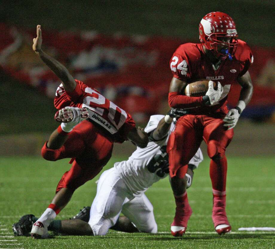 Dulles wide receiver Maurice Smith is tackled by Hightower defensive back Joshua Cook during the first half of a high school football game, Thursday, October 25, 2012 at Mercer Stadium in Sugar Land TX. Photo: Eric Christian Smith, For The Chronicle