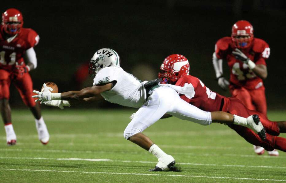 Hightower wide receiver Eric Parker makes a leaping reception past Dulles defensive back Joshua Cook