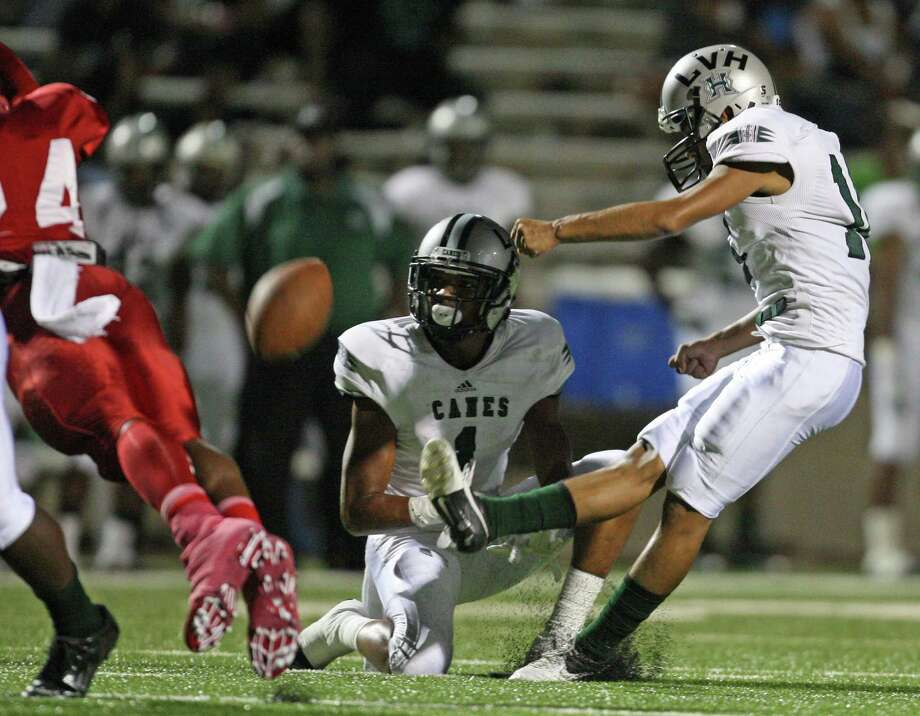 Hightower kicker Andres Lopez (right) connects for a 27-yard field goal during the first half of a high school football game against Dulles, Thursday, October 25, 2012 at Mercer Stadium in Sugar Land TX. Photo: Eric Christian Smith, For The Chronicle