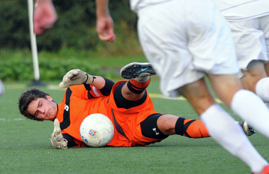 Staples goalie James Hickok stops a Darien ball, during boys soccer action in Westport, Conn. on Wedesday October 10, 2012. Photo: Christian Abraham