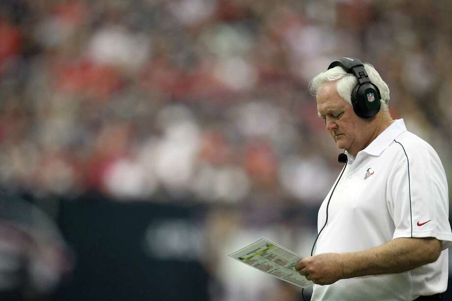 Houston Texans defensive coordinator Wade Phillips looks over his plays during the fourth quarter of his game against the Tennessee Titans at Reliant Stadium on Sunday, Sept. 30, 2012, in Houston. The Houston Texans won 38-14. ( Nick de la Torre / Houston Chronicle ) Photo: Nick De La Torre, Staff / © 2012  Houston Chronicle